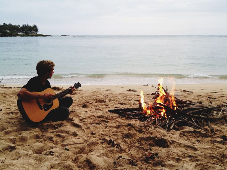 If you play guitar, I'll sing. We can build a campfire on the beach and watch the sun set over the waves crashing against the shore.