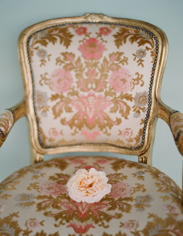 Peach bloom on an antique chair | Photo by Elizabeth Messina