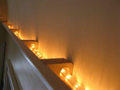 Installing Crown Molding Lighting - on top of built-in bookshelves in basement