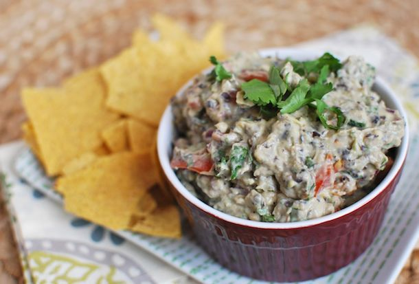 A twist on traditional guacamole, this dip is filled with fiber-rich black beans and protein-packed Greek yogurt, plus heart-healthy fats from the avocados. Dip a few tortilla chips or fresh veggie...