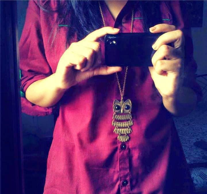 Girl hide face with cam in maroon suit - Facebook Display Pictures