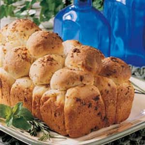 Garlic Herb Bubble Loaf Recipe deliciously different pull-apart loaf that smells heavenly while baking. It has a light crust, tender interior and lots of herb and butter flavor.