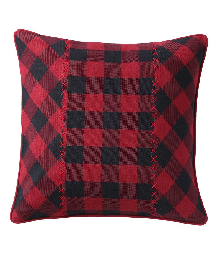 Plaids are given a unique twist with an interesting play of fabric orientation. The hand stitched edges with the christmasy colours give a joyous touch to the cushion. www.theindianpick.com