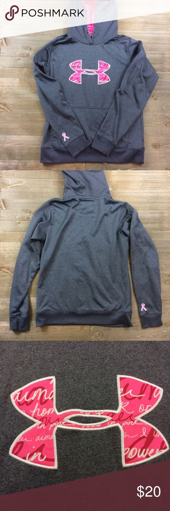 """Under Armour Storm Power In Pink Hoodie Under Armour Storm """"Power In Pink"""" breast cancer hoodie. Dark grey with pink symbol. The inside of the hood is also pink. Kangaroo pouch in front. Breast cancer ribbon on the end of the sleeve. No strings on the hood. Under Armour Tops Sweatshirts & Hoodies"""