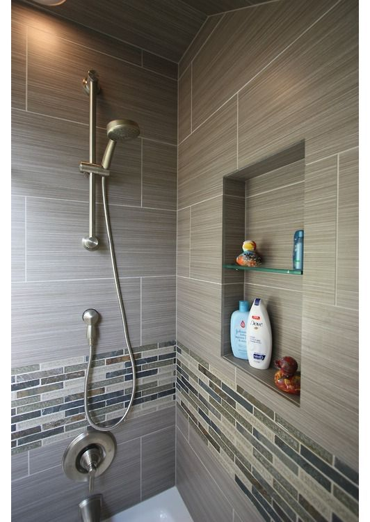 sleek modern accessible shower features include multi height niche different tiles for - Modern Bathroom Tile Designs