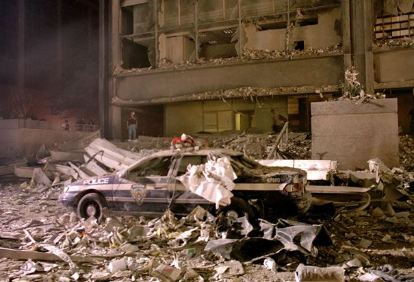 9/11/2001 ~ A New York City Sanitation Police Car Lies Amongst The Dust, Ash, Rubble and Ruins of The Aftermath of The Collapse of Both of The Twin Towers.