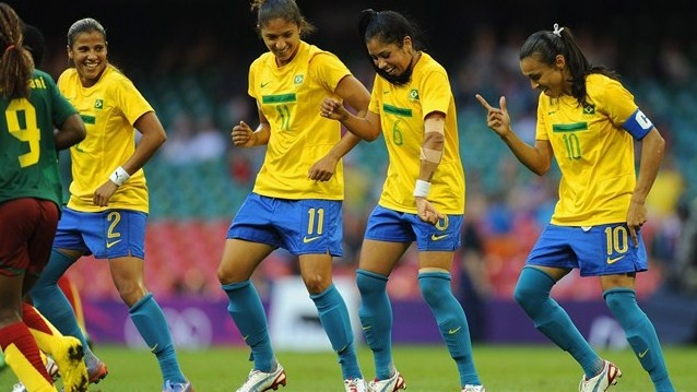 Fabiana, Cristiane and Maurine of Brazil celebrate  Fabiana, Cristiane and Maurine of Brazil celebrate with team mate Marta after her goal to make it 4-0 during the first round women's Football group E match between Cameroon and Brazil at the Millennium Stadium.