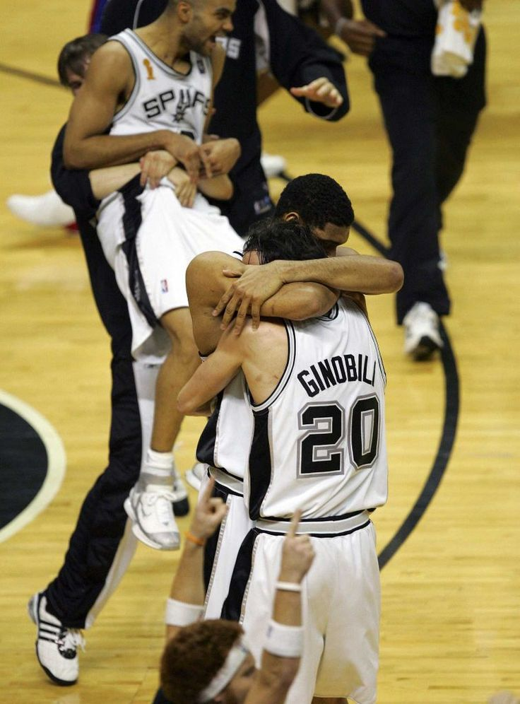 Beno Udrih lifts Tony Parker as Tim Duncan and Manu Ginobili hug after the Spurs' 81-74 victory over the Pistons in Game 7 of the 2005 NBA Finals. Photo: Bahram Mark Sobhani / San Antonio Express-News / SAN ANTONIO EXPRESS-NEWS