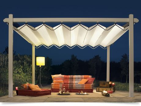 The Isola Fly is an anti-UV ray blackout PVC awning, fitted into an aluminium frame and stainless steel structure.    Using a unique patented system, the awning is opened and stretched utilising lateral stainless steel pantographs, which put the two sides in tension. Movement is transmitted on lateral guides with a high-resistance timing belt.    The stretched fabrics arched solution allows for lateral water drainage.