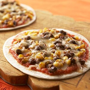 No-Fuss Pizza Recipes: Mini Mexican Pizza (via Parents.com) - When your family craves Mexican food, make this super fast pizza. A tortilla acts as the crust.