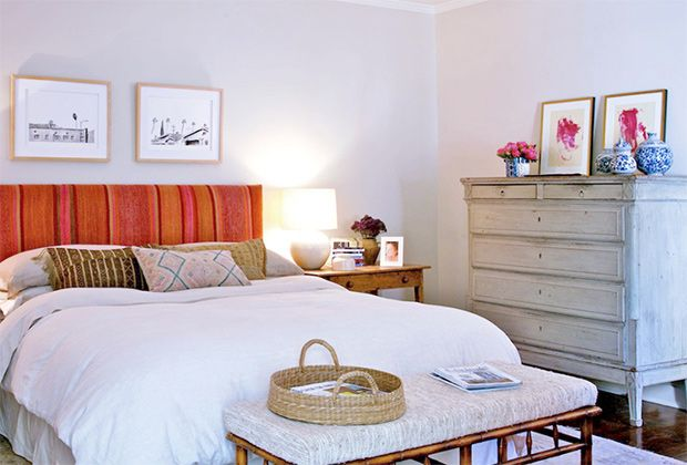 Neutrals tone down the juicyorange and pink headboard in the bedroom, which is the backdrop to one of the movie's most heightenedscenes.   Photo: Courtesy ofHome Again
