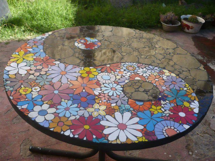 OK - someone has a lot of time and energy invested in this table. If you've ever tried mosaics, we think you'll agree this a great result. We'd be proud of it if it was our work... You'll find lots of other mosaic works by viewing the full album on our site at http://theownerbuildernetwork.co/ideas-for-your-rooms/home-decorating-gallery/mosaic/ Do you like it?