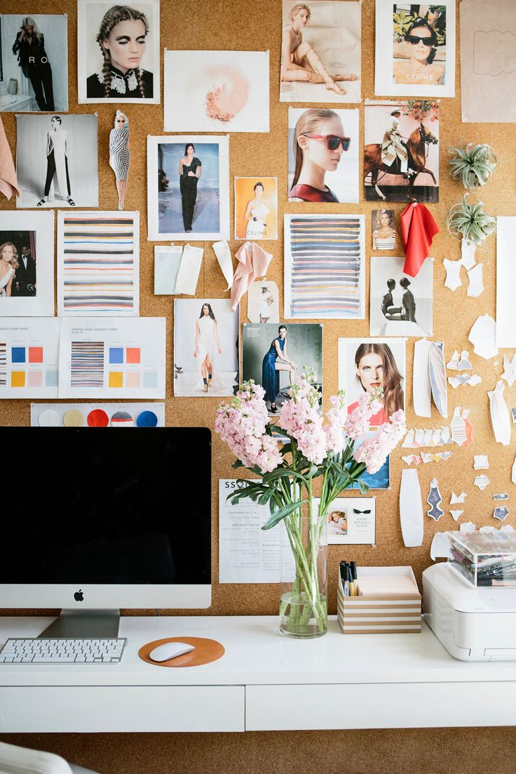 Images of old collections, fabric swatches, bits of inspiration, and her daughter's drawings mingle to create visual stimulation on a cork board.