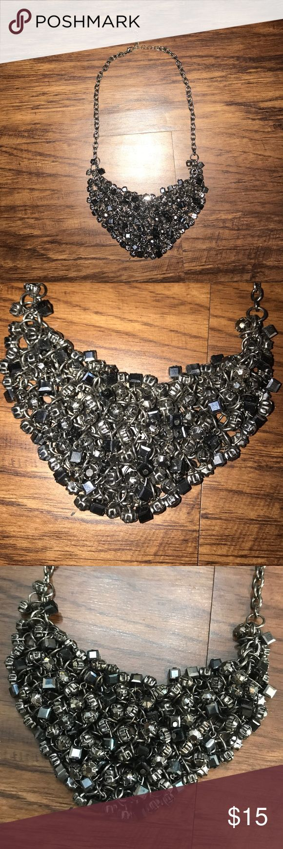 Dark Silver Beaded Bib Statement Necklace this necklace is beautiful and i got so many compliments every time i wore it! dark silver carbon color with different beads all attached in a bib like front piece. very very slight tarnishing on the chain but not visible at all. great condition! purchased from nordstrom. Nordstrom Jewelry Necklaces