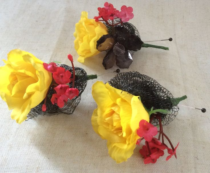 Yellow, red and black corsages by Cathey's flowers
