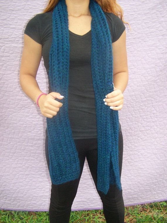 This scarf is knit in a soft, soft, soft thick alpaca yarn to make it warm and cozy. It is a dark blue/green mixture; interestingly, the yarn