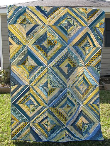 very pretty string quilt with a narrow white strip as the center