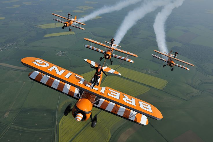 Breitling Wingwalkers perform a breathtaking sequence of acrobatic manoeuvres whilst strapped to the top wings of the team's beautiful Boeing Stearman biplanes. The team pilots fly the aircraft through a well rehearsed energetic routine of dazzling aerobatics and close formation flypasts as the wingwalkers wave at the crowd. The display will be appearing over The Footman James Sywell Classic: Pistons & Props on 26th and 27th September: www.sywellclassic.co.uk