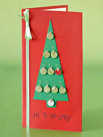 Convey your holiday sentiments with a Christmas tree card decorated with tiny ornaments.