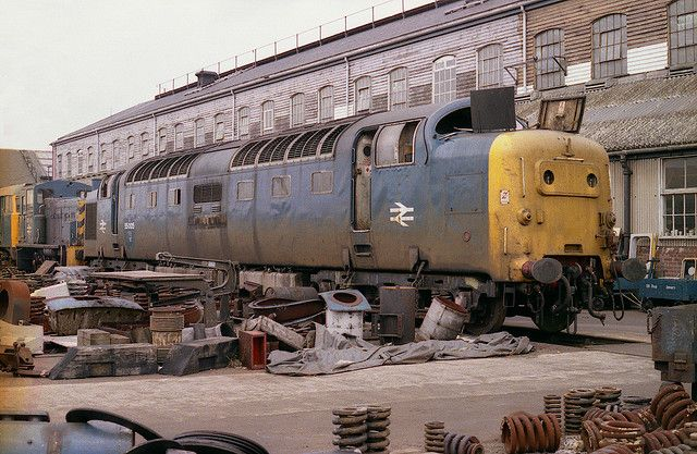 """55005 Doncaster Works. Withdrawn on the 8th February 1981, for no other reason than it was due a classified repair, 55005 (D9005) """"THE PRINCE OF WALES'S OWN REGIMENT OF YORKSHIRE"""" awaits its fate among the detritus of many locomotives at Doncaster Works on Sunday 3rd May 1981."""