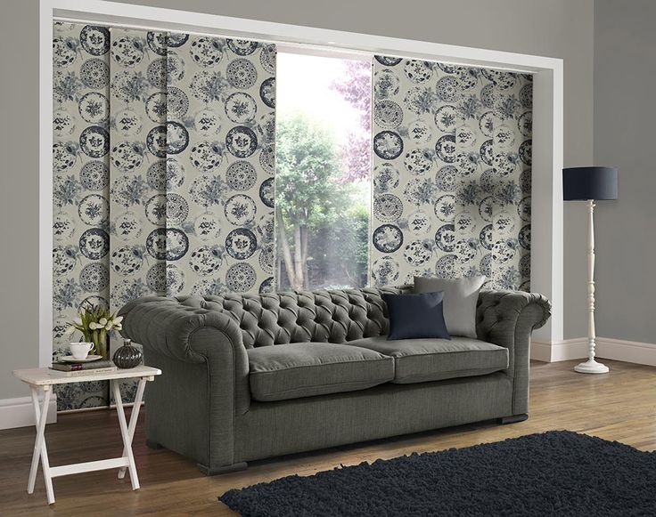 Panel blind is the most innovative shading solution for larger windows and patio doors. This blind also looks stunning as a stylish room divider. Here in dark blue round flowery pattern. Bolton Blind's panel blind is available in a diverse range of designs and fabrics including, sheer voiles and faux suede, all of which will enhance the decor of any room.