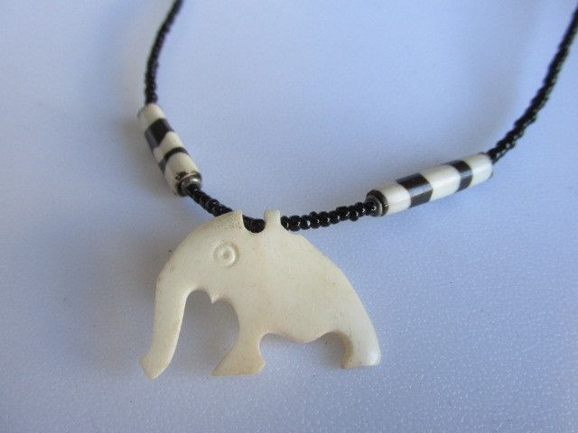Shared Treasures Boutique - Authentic African Bone and Bead Elephant Necklace - (Zulu), $14.69 (http://www.sharedtreasuresboutique.com/authentic-african-bone-and-bead-elephant-necklace-zulu/)