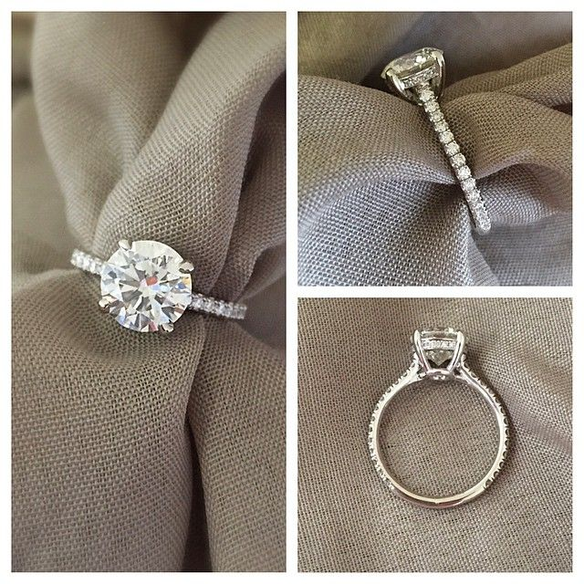 Love this setting! Round brilliant cut solitaire engagement ring on thin 4 prong micropave eternity band