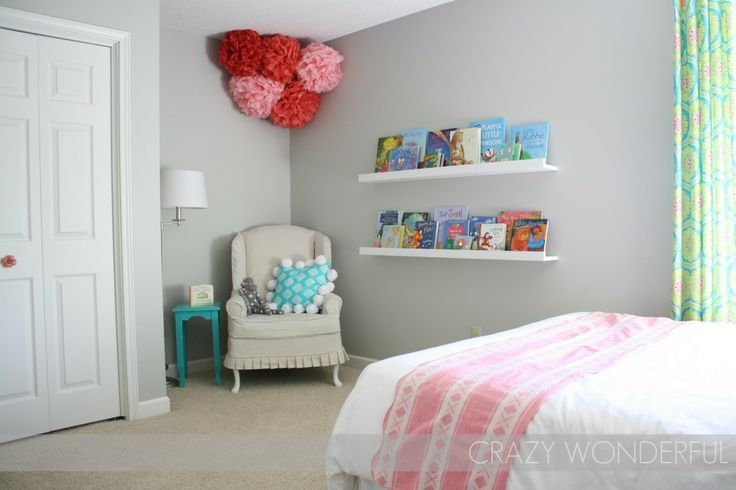 Turquoise and Pink Big Girl Room - we love the pompoms and the reading nook!