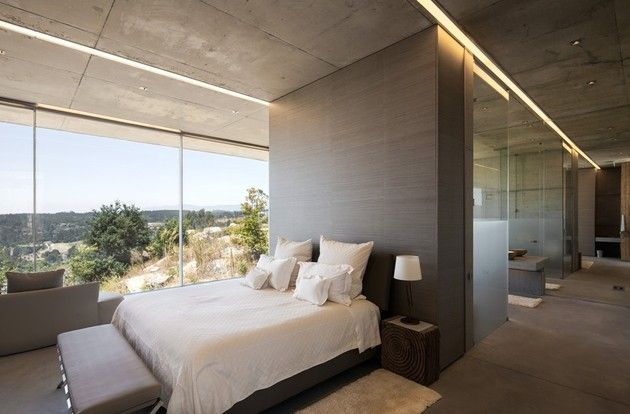 Luxury Vineyard Accommodations Featuring Spectacular Glass-Wall Views, Portugal. Because of the carefully-sculpted shape of the hotel, rather intimate areas like bedding and showers can be kept close to the windows with no fear of being seen by fellow guests or vineyard workers.