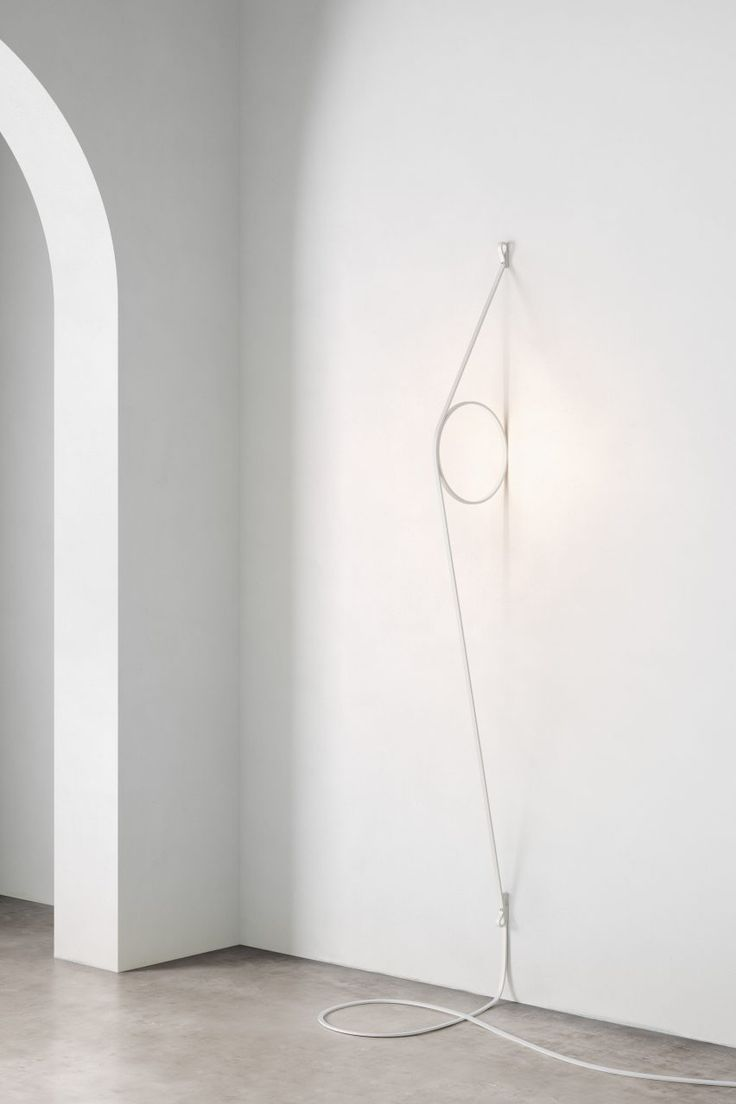 Wire Ring by Formafantasma for Flos    A flattened power cord forms a sculptural support for this wall light – one of two that Italian duo Formafantasma has designed for Italian brand Flos. Soft illumination comes from the central LED ring.
