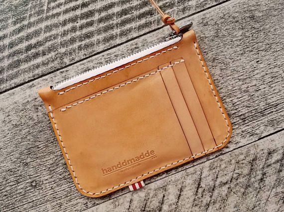 Made from premium cowhide natural vegetable leather. • 8,5 x 11,5 cm • Capacity: three card or bills compartments (two front, one back). Internal zipper compartment as coin purse (works as bills compartment). • Designed to carry just the essentials, ultra thin design. Handcrafted