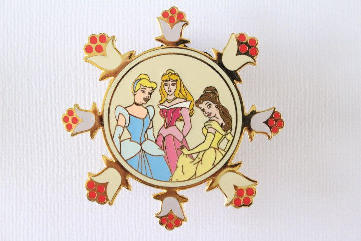 This rare Disney pin for sale features Three Princesses, Cinderella, Sleeping Beauty's Briar Rose, and Beauty and the Beast's Belle. They are framed by a detailed flower pattern and it is a very large