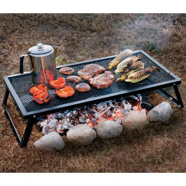 Camp Chef Over-The-Fire Cooking Grills at Cabelas - cheap alternative to a grill, plus, you get to make a fire!