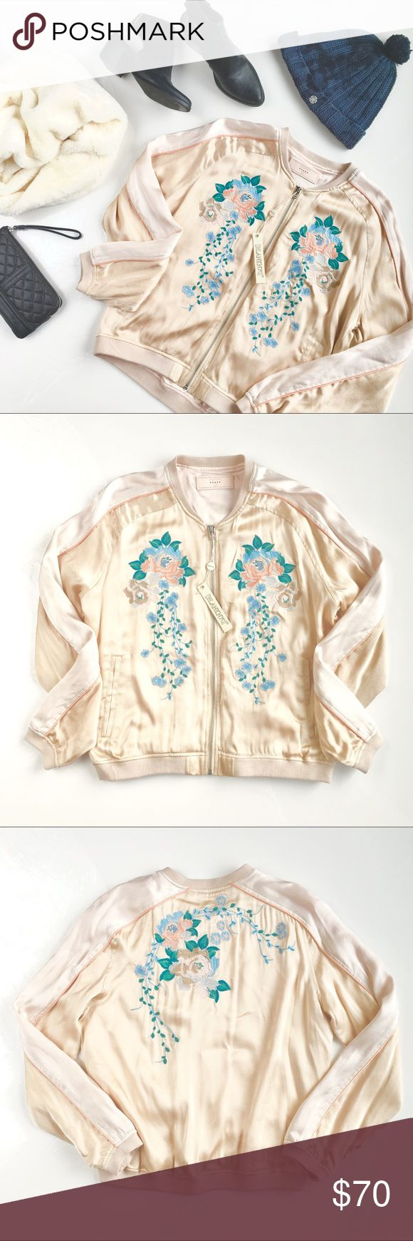 "BlankNYC Floral Embroidered Peach Satin Bomber, M An absolutely gorgeous bomber jacket from one of the best street-style labels, Blank NYC, with beautiful floral waterfall embroidery in sweet peach & pastel blues, functional pockets, and double-lining. Small imprint from security tag as shown, will erase with time/steam, price lowered to reflect. Size M, fits sizes S-M, measures approx 17"" across shoulders, 21"" across chest, 23"" long. Brand new, NWT. Please feel free to make an offer, bundle…"