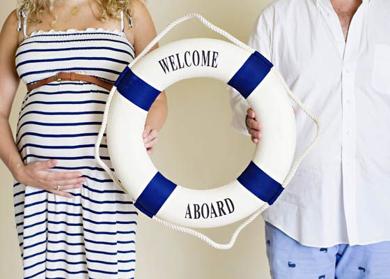 "My friend/coworker Kelly and her husband. So cute! ""welcome aboard"" baby!"