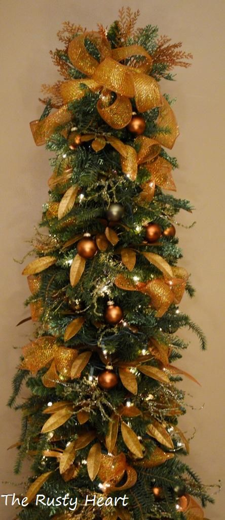 Blue mesh decorated christmas tree | Here is a 6ft Pencil Tree Decorated with Mesh Ribbon.