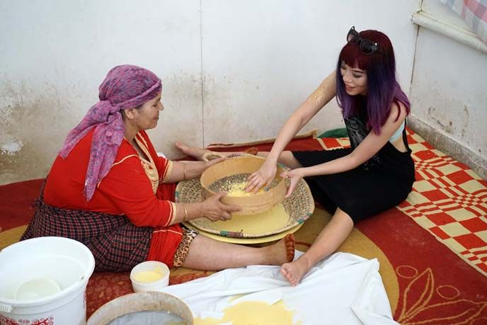 couscous lesson fez morocco, visiting women run bakery and learning cooking classes in Fez, Morocco. More about my cooking lesson at http://www.lacarmina.com/blog/2015/11/henna-morocco-beauty-tattoo-fez-cooking-class/
