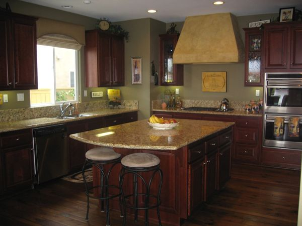 Sage green dark wood kitchen for Dark walls in kitchen