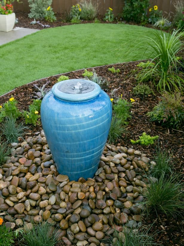 Yard Crashers: Water-Feature Wonderland : A bright blue and bubbly urn fountain adds color and charm to the landscape in a newly remade San Diego backyard. From DIYnetwork.com