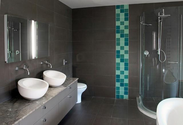 As a blue strip and with white wall tiles and a lighter floor.