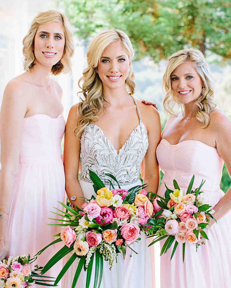 A Boho California Wedding with a Tropical Twist | Martha Stewart Weddings - Stephanie's sisters served as her bridesmaid and maid-of-honor, donning light pink Rebecca Taylor gowns and carrying petite bouquets of ranunculus, roses, blushing bride protea, and parrot tulips.
