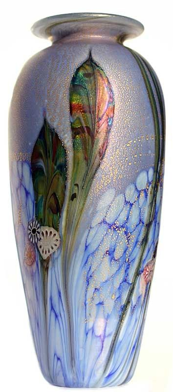 *JOHNATHAN HARRIS STUDIO GLASS LTD. ~ Eden-Amphora-vase-Lapis. This lovely new design is richly decorated w/ mulptiple layers of enamel, chips, trails, millifleur + 25 ct. gold leaf. The colourful, organic leaves + buds are skilfully entwined around the form + compliment the peaceful + tranquil garden.
