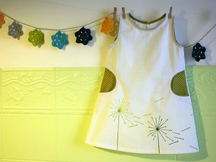 Olive polka dots. And dandelion motif. And those perfect  inset pockets.