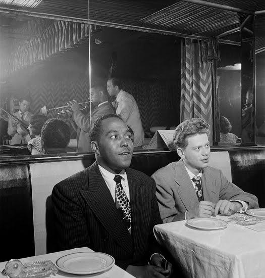 Charlie Parker and Red Rodney watching Dizzy Gillespie.  photograph by William Gottlieb, 1947.