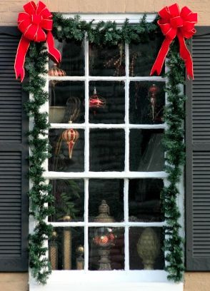 Christmas window with garland and ornaments