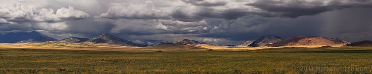CINDER CONE Panorama - A chain of dormant volcanos north of Flagstaff, AZ. Shot at high noon as monsoon storms were about to explode. Four horizontal exposures blended together for a panorama.  Please click on the photo for a better view.