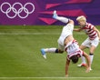 USA's Rapinoe and Wambach do their trademark cartwheels after Wamback scored on New Zealand during their women's quarter final soccer match at the London 2012 Olympic Games at St James' Pa
