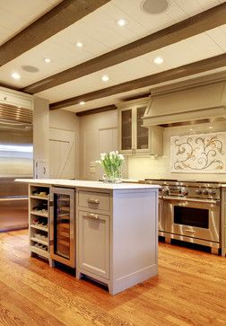 island with wine cooler and rack... make large cabinet into pull out trash can storage