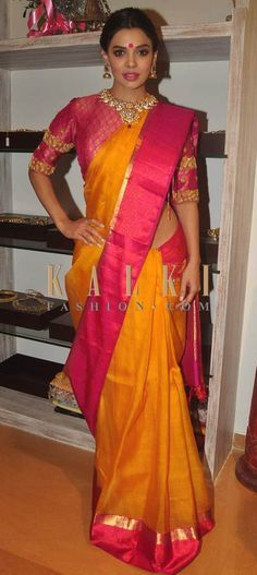 Gorgeous pink and yellow silk saree teamed with statement blouse and necklace. Love her jhumkis and pink lips. Must have Bollywood Style! Find a style match to the celebrity look of your choice @http://www.kalkifashion.com/sarees.html