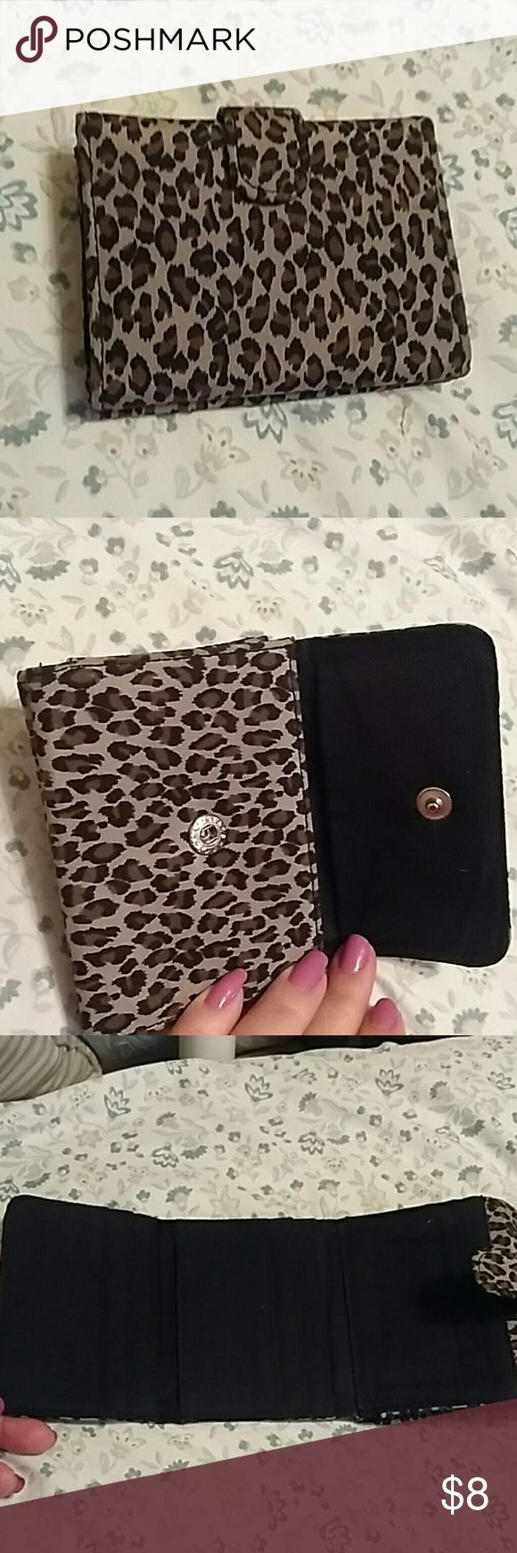 Leopard print wallet EUC leopard print wallet with six credit card pockets, an id pocket, and front buttoned pocket for cash or coins. unbranded Accessories Key & Card Holders